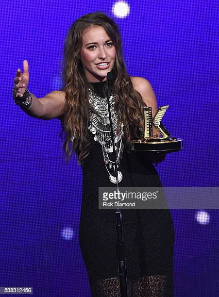 Lauren Daigle accepts an award onstage at the 4th Annual KLOVE Fan Awards at The Grand Ole Opry House on June 5 2016 in Nashville Tennessee