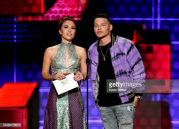 Lauren Daigle and Kane Brown speak onstage during the 2018 American Music Awards at Microsoft Theater on October 9 2018 in Los Angeles California