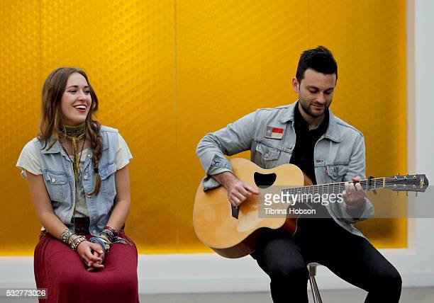 Lauren Daigle and Vince Dicarlo perform at a special inoffice performance at Rogers Cowan on May 19 2016 in Los Angeles California