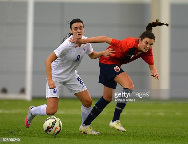 Lauren Davies of England challenges Ingrid Syrstad Engen of Norway during the U19 Women's Friendly match between England U19 Women and Norway U19...