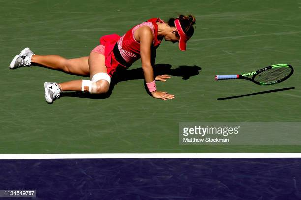 Lauren Davis falls while playing Garbine Muguruza of Spain during the BNP Paribas Open at the Indian Wells Tennis Garden on March 08, 2019 in Indian...
