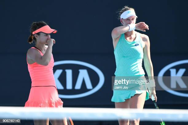 Lauren Davis of the United States and Alison Riske of the United States talk tactics in their first round women's doubles match against Dalila...