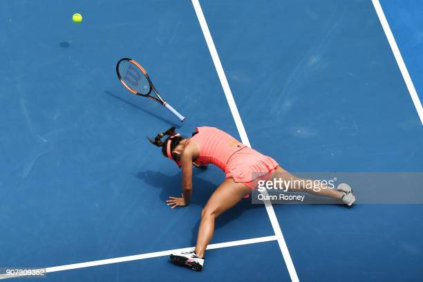 Lauren Davis of the United States falls in the third set of her third round match against Simona Halep of Romania on day six of the 2018 Australian...