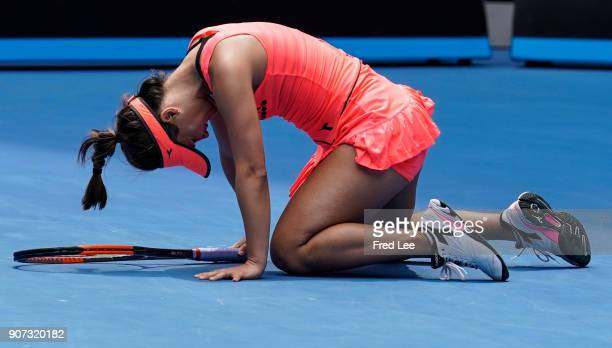 Lauren Davis of the United States injures her foot in a fall in her third round match against Simona Halep of Romania on day six of the 2018...