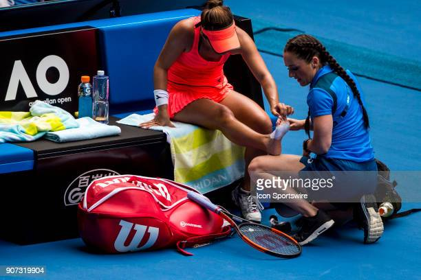 Lauren Davis of the United States of America receives medical treatment to her foot in her third round match during the 2018 Australian Open on...