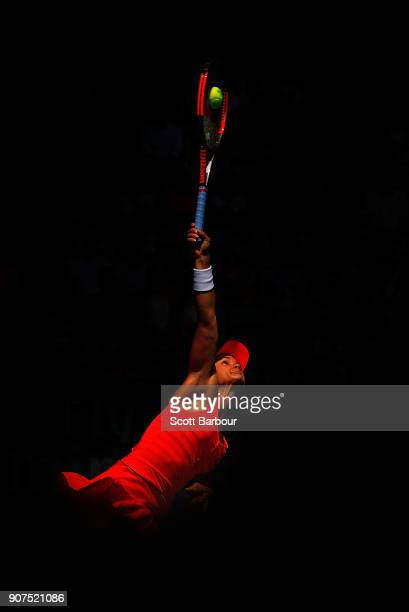 Lauren Davis of the United States serves in her third round match against Simona Halep of Romania on day six of the 2018 Australian Open at Melbourne...