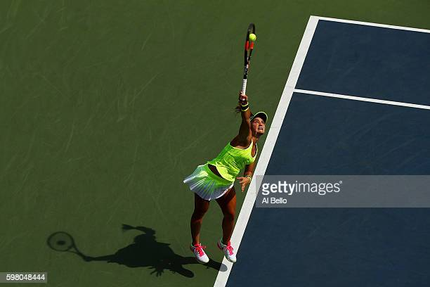 Lauren Davis of the United States serves to Elina Svitolina of the Ukraine during her second round Women's Singles match on Day Three of the 2016 US...