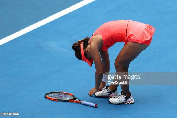 Lauren Davis of the United States struggles with an injured foot in her third round match against Simona Halep of Romania on day six of the 2018...