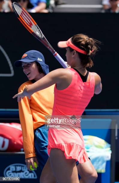 Lauren Davis of the US hits a return against Romania's Simona Halep during their women's singles third round match on day six of the 2018 Australian...