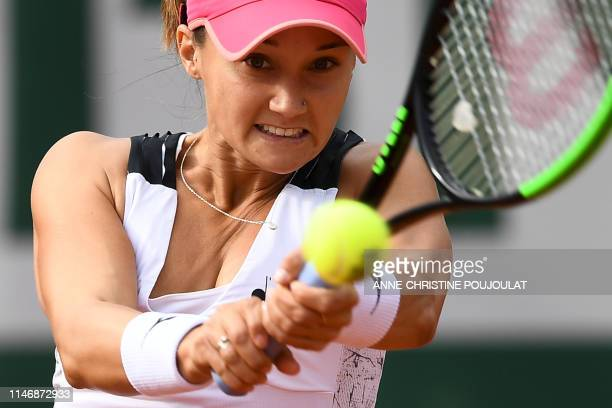 Lauren Davis of the US returns the ball to Britain's Johanna Konta during their women's singles second round match on day four of The Roland Garros...