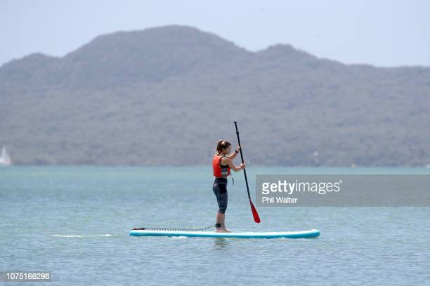 Lauren Davis of the USA paddleboards at Mission Bay beach in Auckland ahead of the 2019 ASB Classic, on December 27, 2018 in Auckland, New Zealand.