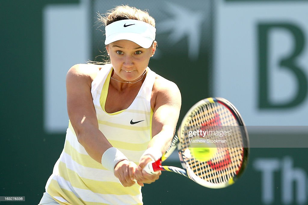 Lauren Davis returns a shot against Simona Halep of Romania during the BNP Paribas Open at the Indian Wells Tennis Garden on March 6, 2013 in Indian Wells, California.