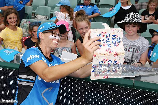 Lauren Ebsary of the Adelaide Strikers takes a selfie with spectators after the Women's Big Bash League match between the Adelaide Strikers and the...