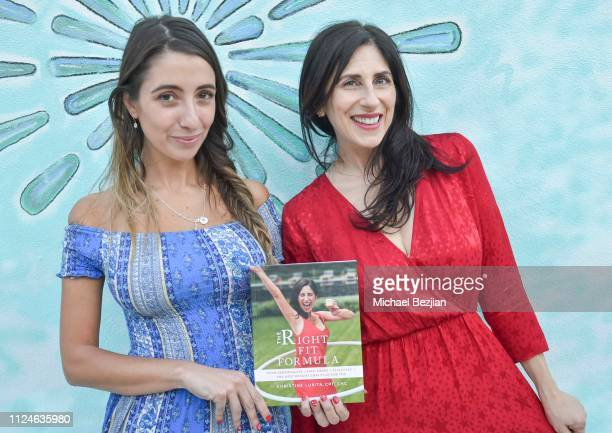 Lauren Francesca and Christine Lusita pose infront of Visual Snow Initiative with her book The Right Fit Formula at TAP Giveback Day on January 24...