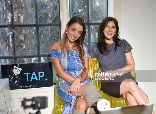 Lauren Francesca and Christine Lusita pose with her book The Right Fit Formula at TAP Giveback Day on January 24 2019 in Los Angeles California