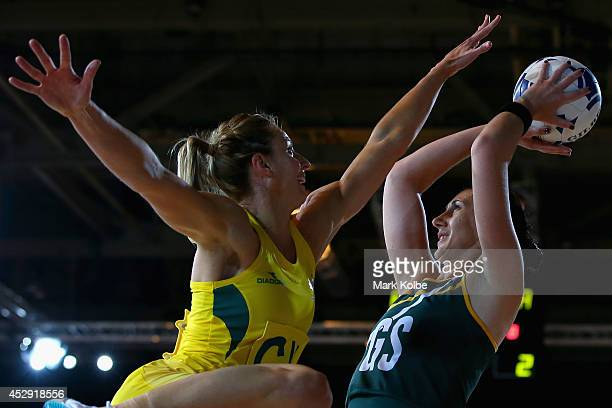 Lauren Geitz of Australia tries to block the shot of Anna Bootha of South Africa during the preliminary round netball match between Australia and...