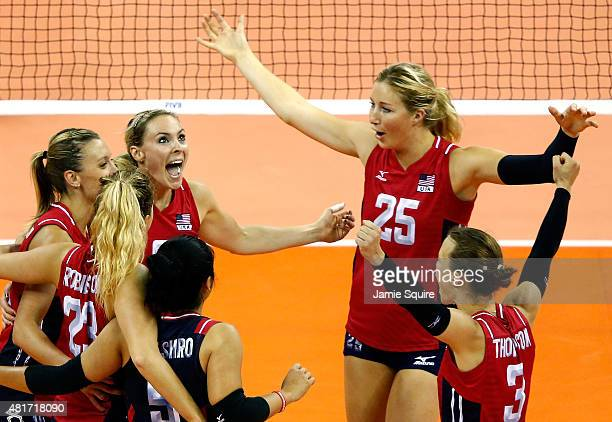 Lauren Gibbmeyer and Karsta Lowe of the USA celebrate after a point during the final round match against Italy on day 2 of the FIVB Volleyball World...