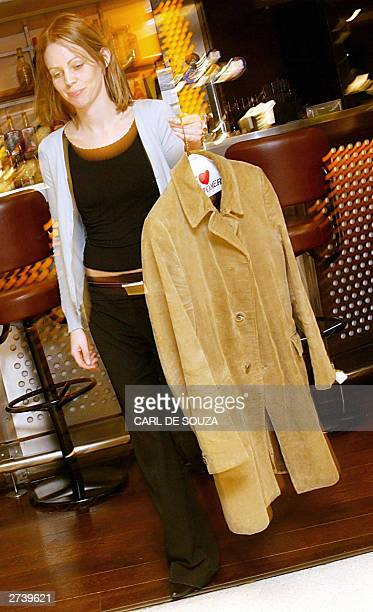 Lauren Gildersleve carries a beige corduroy three quarter length jacket owned and worn by former Beatles John Lennon 18 November 2003 is London Ted...