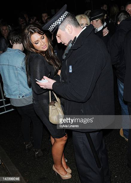 Lauren Goodger gives her details to a police officer as she leaves The Bankside Vaults also known as Pulse on April 3 2012 in London England Around...