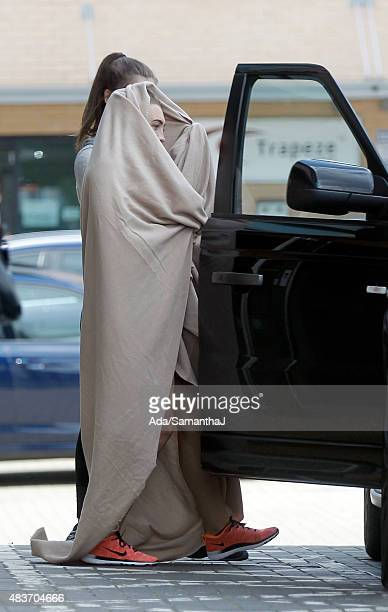 Lauren Goodger pictured leaving her local gym with a bedsheet wrapped round her on August 7 2015 in Loughton Essex