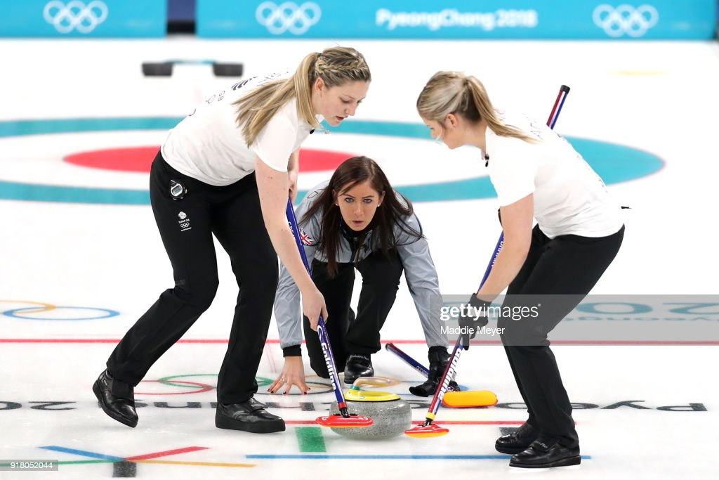 Lauren Gray, left, and Vicki Adams sweep the ice in front of a stone cast by Eve Muirhead of Great Britain during Women's Round Robin Session 1 on day five of the PyeongChang 2018 Winter Olympic Games at Gangneung Curling Centre on February 14, 2018 in Gangneung, South Korea.