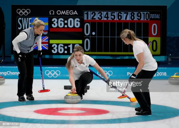Lauren Gray of Great Britain throws a stone surrounded by Anna Sloan and Vicki Adams during the women's curling semifinal game between Sweden and...