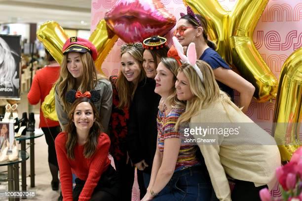 Lauren Harrison, Lauren Auslander, Koko Bahler, Tina Simpson, Peggy Merck, Dre Bowling and Juliann Hinrichs take photos during Jessica Simpson's...