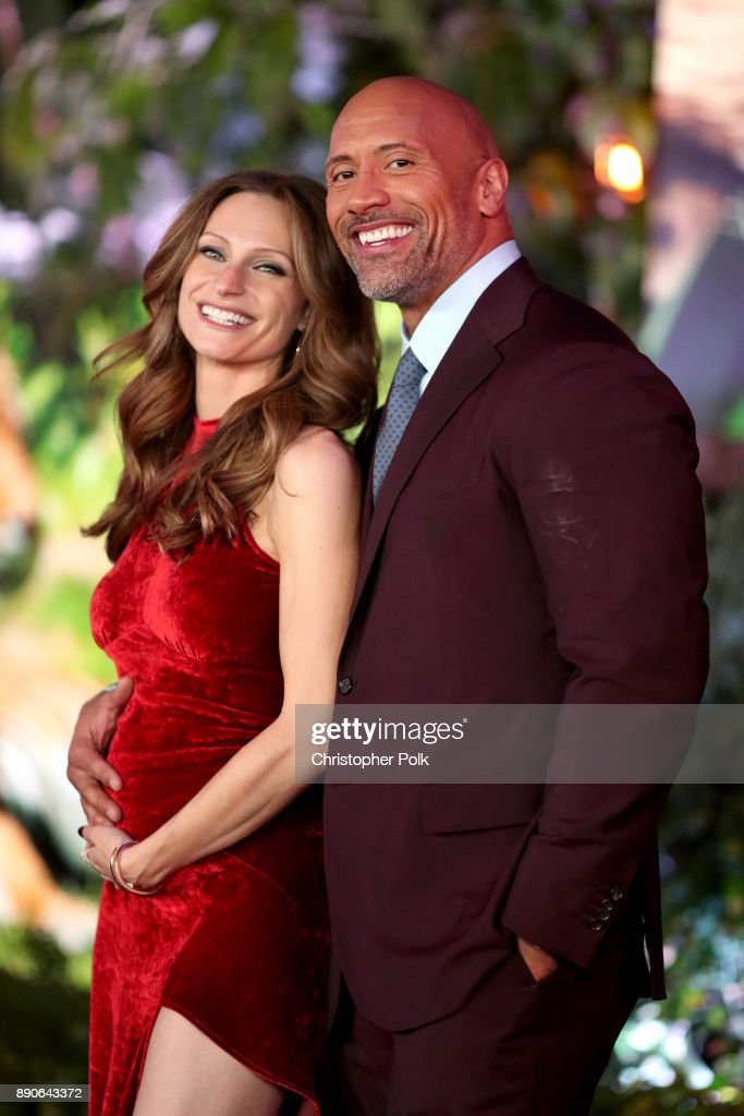 Lauren Hashian (L) and Dwayne Johnson attend the premiere of Columbia Pictures' 'Jumanji: Welcome To The Jungle' on December 11, 2017 in Hollywood, California.