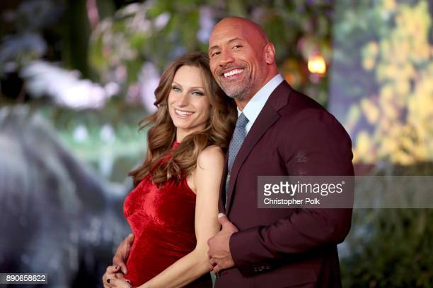 Lauren Hashian and Dwayne Johnson attend the premiere of Columbia Pictures' Jumanji Welcome To The Jungle on December 11 2017 in Hollywood California