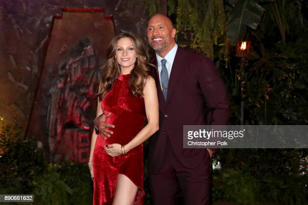 Lauren Hashian and Dwayne Johnson attend the premiere of Columbia Pictures' 'Jumanji Welcome To The Jungle' on December 11 2017 in Hollywood...