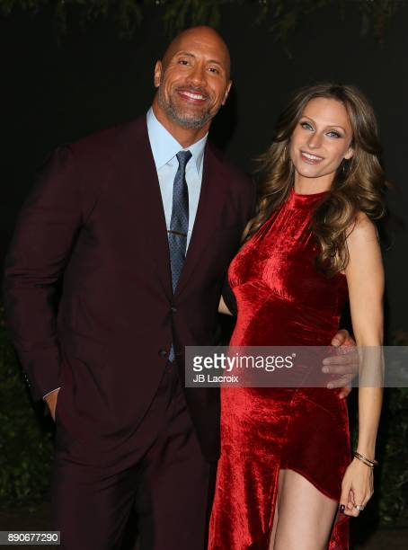 Lauren Hashian and Dwayne Johnson attend the premiere of Columbia Pictures' 'Jumanji: Welcome To The Jungle' on December 11, 2017 in Los Angeles,...