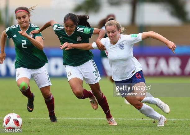 Lauren Hemp of England breaks away from Miriam Garcia of Mexico during the group B match between England and Mexico at Stade de Marville on August 12...