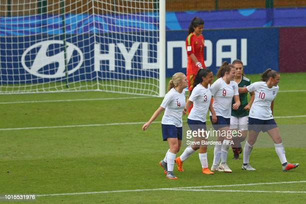 Lauren Hemp of England celebrates scoring a goal with her team mates during the group B match between England and Mexico at Stade de Marville on...