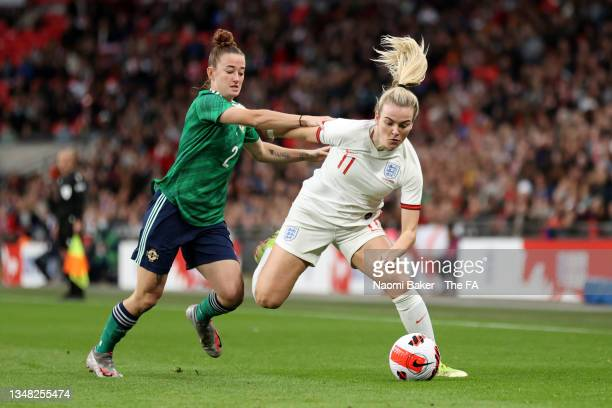 Lauren Hemp of England is challenged by Rebecca McKenna of Northern Ireland during the FIFA Women's World Cup 2023 Qualifier group D match between...