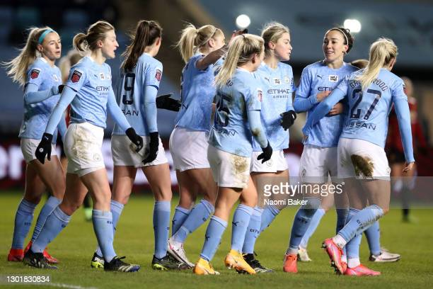 Lauren Hemp of Manchester City celebrates scoring her sides second goal with Lucy Bronze of Manchester City and team mates during the Barclays FA...