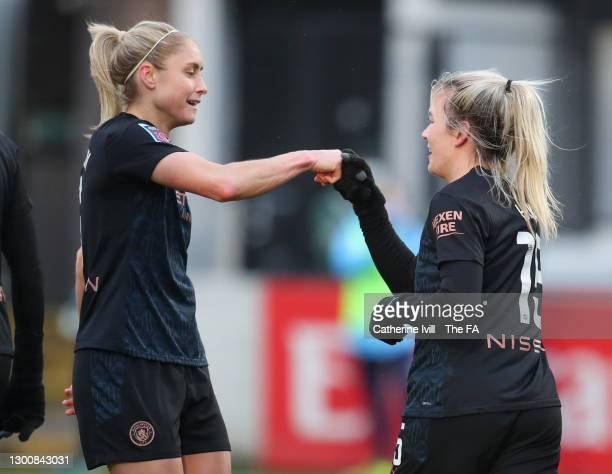 Lauren Hemp of Manchester City celebrates with team mate Steph Houghton after scoring their side's second goal during the Barclays FA Women's Super...
