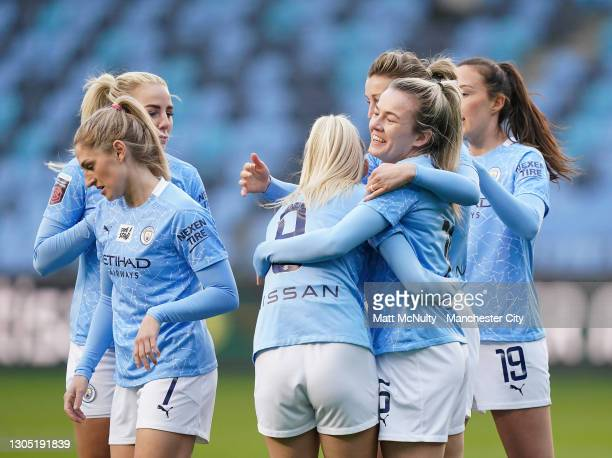 Lauren Hemp of Manchester City celebrates with teammates after scoring her teams first goal during the Women's UEFA Champions League Round of 16...