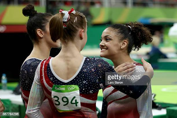 Lauren Hernandez of the United States is congratulated by her team mates Alexandra Raisman and Madison Kocian after competing on the balance beam...