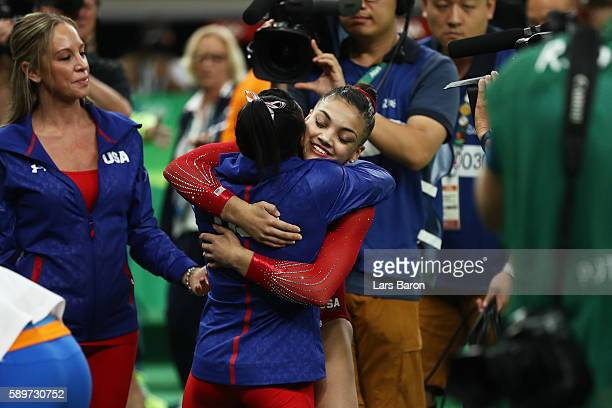 Lauren Hernandez of the United States is congratulated by Simone Biles after competing in the Balance Beam Final on day 10 of the Rio 2016 Olympic...
