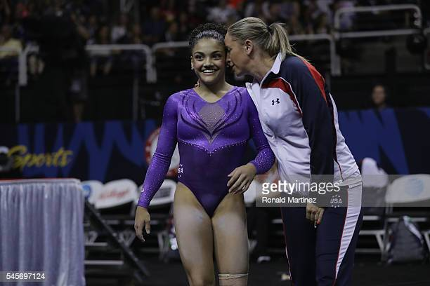 Lauren Hernandez with Maggie Haney after competing on the balance beam during day 1 of the 2016 US Olympic Women's Gymnastics Team Trials at SAP...