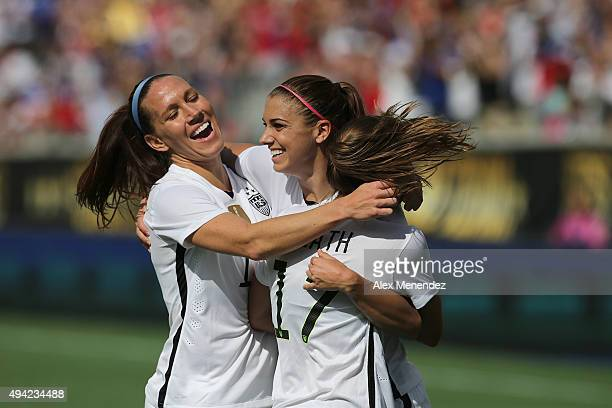 Lauren Holiday Alex Morgan and Tobin Heath of USWNT celebrate a goal during a women's international friendly soccer match between Brazil and the...