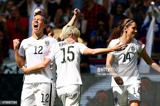 Lauren Holiday and Megan Rapinoe of the United States celebrate after Holiday scores her first goal in the first half against Japan in the FIFA...