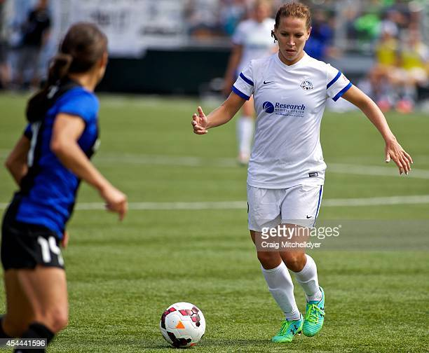 Lauren Holiday of FC Kansas City brings the ball forward against Stephanie Cox of Seattle Reign FC in the second half of the National Women's Soccer...