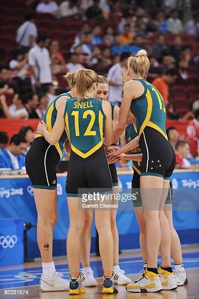 Lauren Jackson and Belinda Snell of Australia huddles against Belarus during day one of basketball at the 2008 Beijing Summer Olympics on August 9...