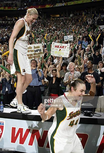Lauren Jackson and Tully Bevilaqua celebrate the Seattle Storm's victory over the Connecticut Sun by a score of 7460 in Game 3 of the WNBA Finals...