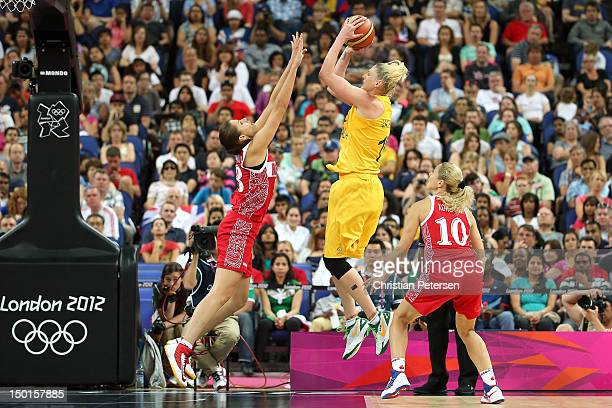 Lauren Jackson of Australia attempts a shot in the second half against Anna Petrakova and Ilona Korstin of Russia during the Women's Basketball...