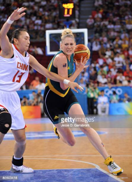 Lauren Jackson of Australia drives against Liu Dan of China during the Women's Semifinals basketball game at the Wukesong Indoor Stadium during Day...
