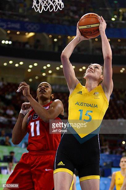 Lauren Jackson of Australia goes up for a shot against Tina Thompson of the United States during the women's basketball gold medal game at the...
