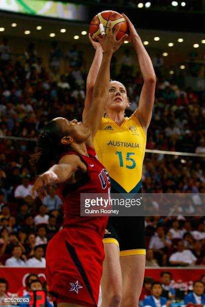 Lauren Jackson of Australia shoots over Tina Thompson of the United States during the women's basketball gold medal game at the Beijing Olympic...