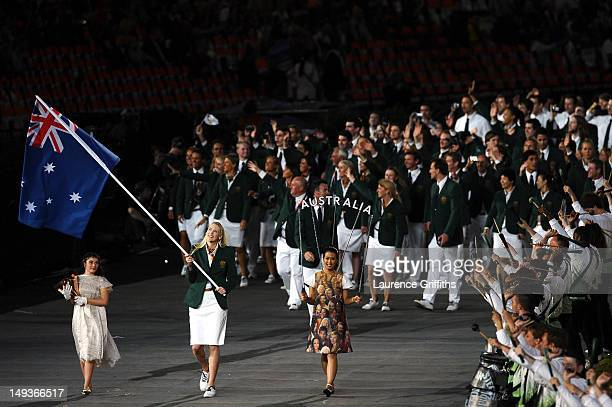 Lauren Jackson of the Australia Olympic basketball team carries her country's flag during the Opening Ceremony of the London 2012 Olympic Games at...
